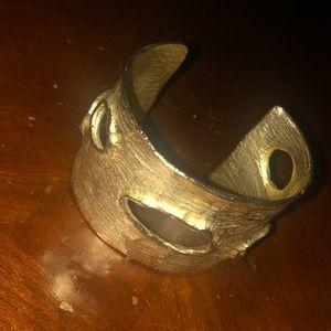 a Chico's gold bracelet cuff